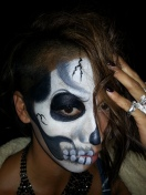 Half skeleton face paint by Cynnamon/Bay Area Party Entertainment